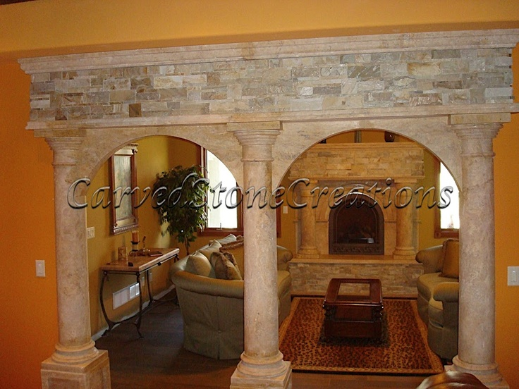 The Stone Veneer At Top Of Entry And Column Style Compliments Same Detail On Fireplace Surround In Room