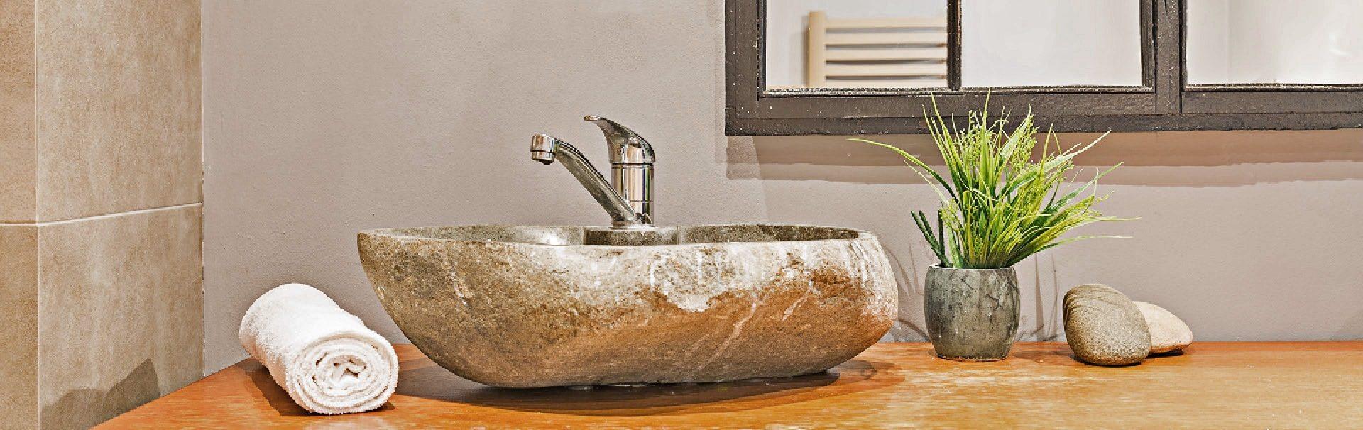 stone boulder bathroom sink