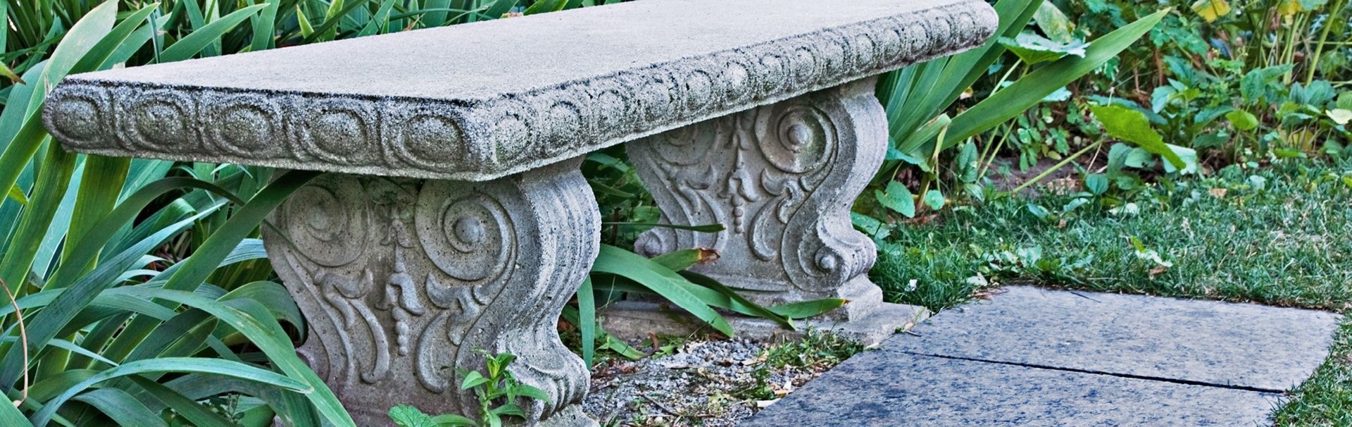 handcarved stone bench