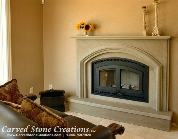 A contemporary Travertine fireplace surround for a gas fireplace.