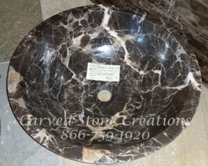 Unrimmed Vessel Sink carved of Polished Dark Emperador Marble. Dimensions:  D17 x H6""