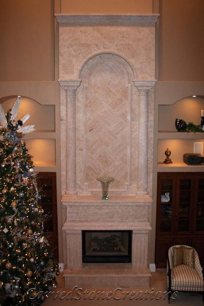 Two-story travertine fireplace
