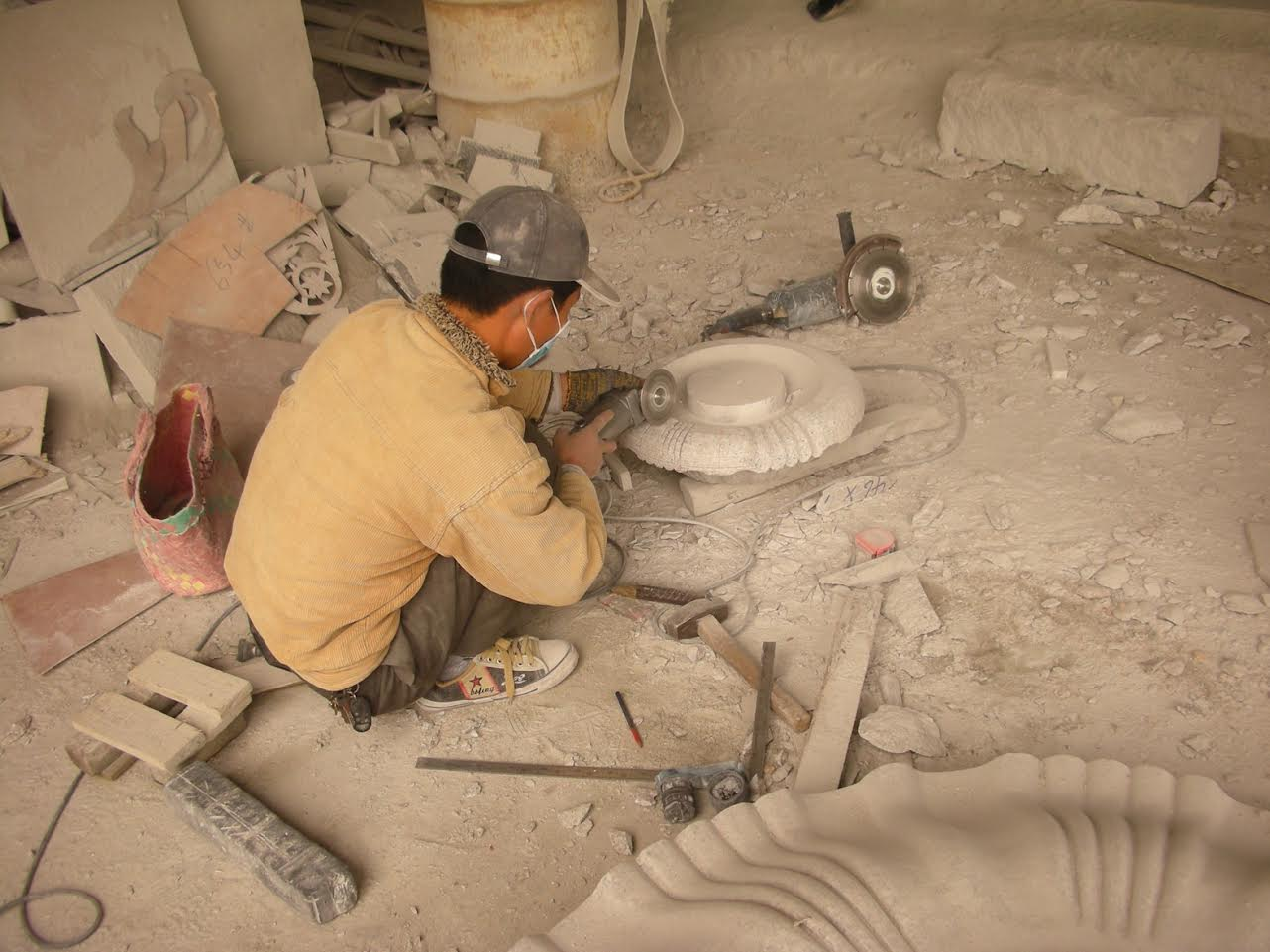 Artisan carving stone fountain
