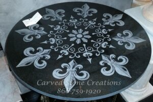 "Fleur de Lis Laser-Etched Black Table Top or Floor Medallion, made from Absolute Black Granite. Diameter 24"" x 5/8"" thick"