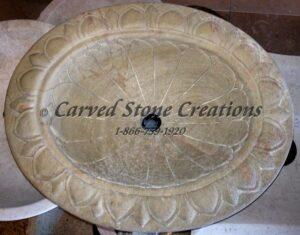 Carved oval sink with egg-dart rim detail