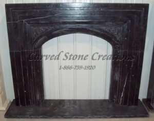 Black Marble Arched Surround with Relief & Hearth