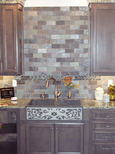 Apron front stone sink