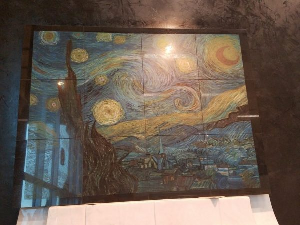 Shiny black granite tiles etched with Van Gogh Inspired Starry Night etching.